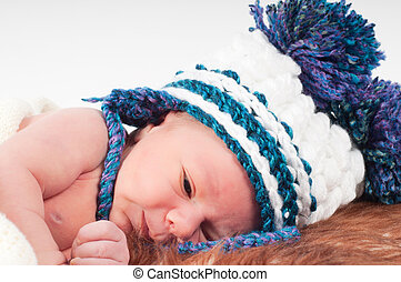 Newborn baby in knitted hat with pom-pons - Shot of newborn...
