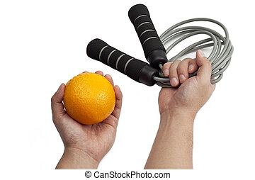 person with resistance band and orange - Close-up shot of...