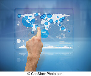 Hand pointing a futuristic screen with the world map and...