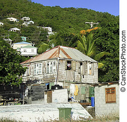 old clapboard Caribbean style wood house with zinc metal...