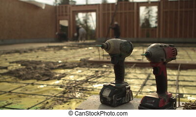 drills with construction site in background