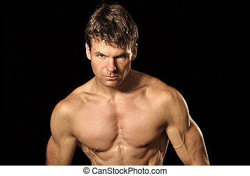 Intensity - Lean and muscular shirtless Caucasian man looks...