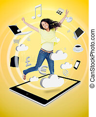 Cute woman jumping on a tablet pc against a digital yellow...