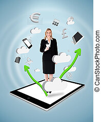 Smiling businesswoman holding a coffee on a tablet pc...