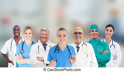 Smiling medical team standing in line on blurred background