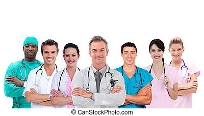 Smiling medical team standing arms crossed in line on white...