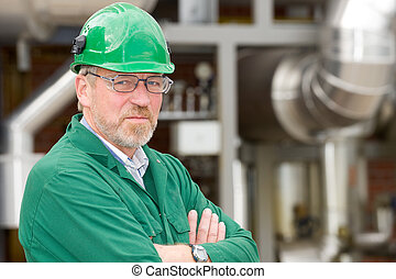 Engineer - Middle ages industrial worker in front of some...