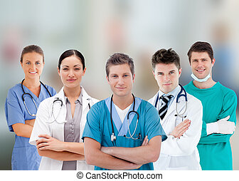 Smiling hospital workers standing in line on fuzzy...