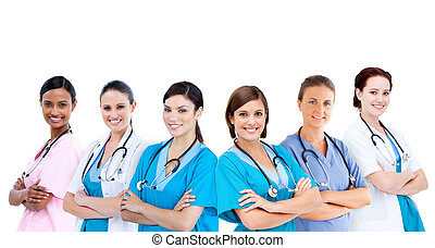 Smiling female hospital workers standing arms folded in line...