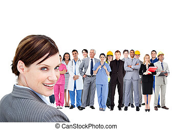 Smiling businesswoman ahead a group