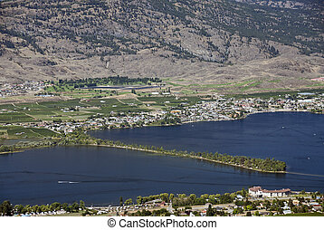 Vineyards by Osoyoos Lake and Osoyoos Campsite in the lake