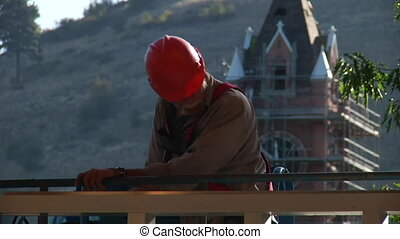 construction worker with hardhat and clock tower