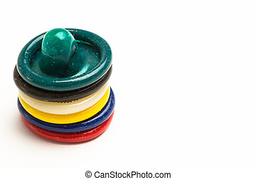 Stack of colourful condoms on white background with copy...