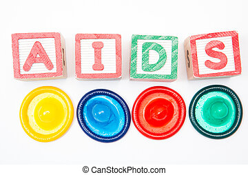 Wood blocks spelling out aids with four colorful condoms on...