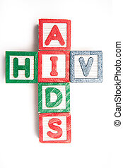 Wood blocks spelling aids and HIV in a cross shape on white...