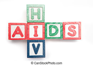 Wood blocks spelling aids and HIV in a cross shape on its...