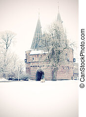Old defense gate at Wintry city park in Kampen, Netherlands...