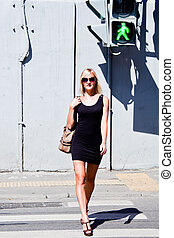 woman near the traffic lights - young and beautiful woman...