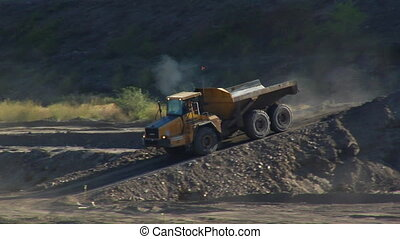large dump truck creates dust