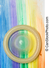 Rolled up condom on rainbow brush - Rolled up condom on gay...