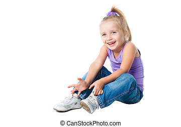 happy little girl in purple t-shirt and jeans - smiling...
