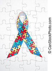 Awareness ribbon for autism and aspergers on white jigsaw...