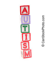 Autism spelled out in stacked letter blocks with copy space...
