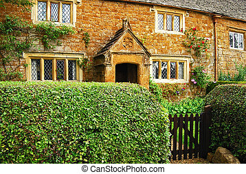 Old country stone house hedgerow wooden door