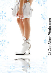 white purse and leather boots with water - closeup of...