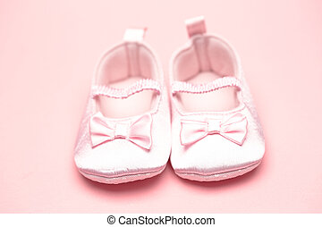 Baby girls pink booties on pink background
