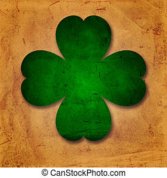 green four-leaved shamrock in old paper background