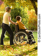 woman in wheelchair - Disabled senior woman in a wheelchair...