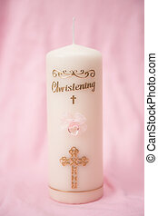 Christening candle with pink detail on textured pink...