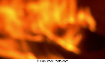 out of focus firewood burning slowly comes into focus
