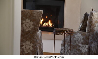 cozy chairs in front of gas fireplace