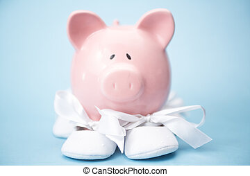 Piggy bank wearing baby booties on blue background