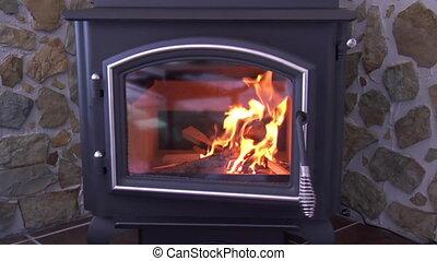 kindling burning in woodstove