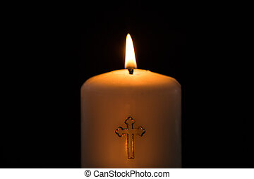 Candle with cross embellishment - Candle with golden cross...