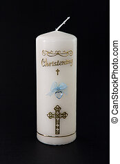 White christening candle with blue detail on black...