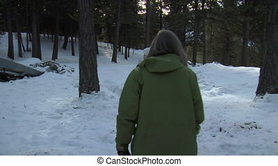 woman walks by camera in snow