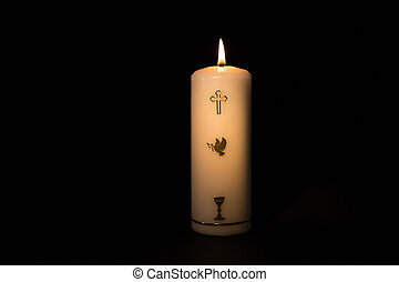 Holy candle burning - Holy candle with gold embellishment...