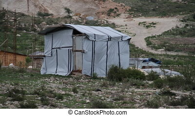 tarp covered shack in Haiti