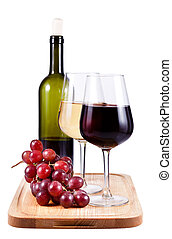 two wine glasses with red and white wine, bottle of wine and...