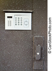 intercom in steel door - Close-up of building intercom in...