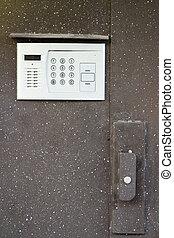 intercom in steel door - Close-up of building intercom in...