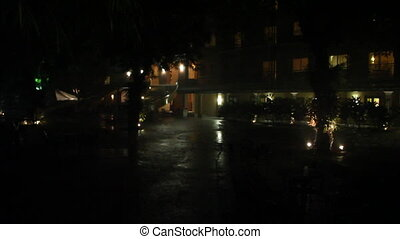 extreme tropical rain in hotel courtyard