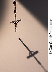 Crucifix casting a shadow - Crucifix from rosary beads...