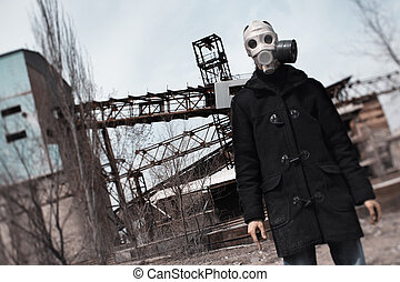 Doom - Man in gas mask standing at the factory after...