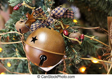 Old jingle bell decoration on tree