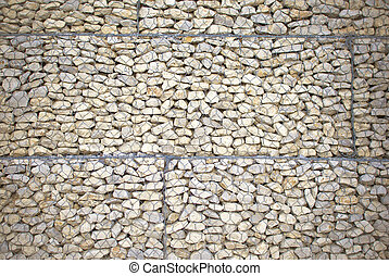 Stone wall with wire mesh for  background